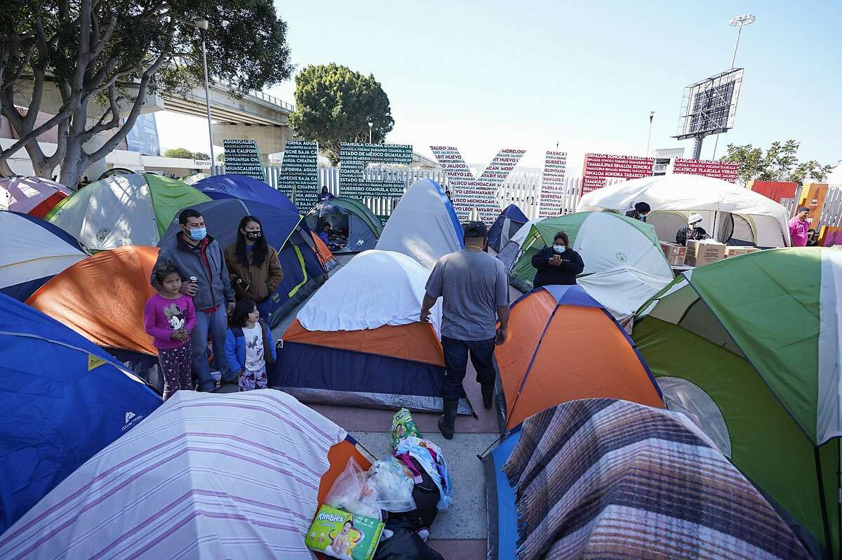 Asylum seekers have set up tents as they settle in at El Chaparral port of entry on Wednesday in Tijuana.