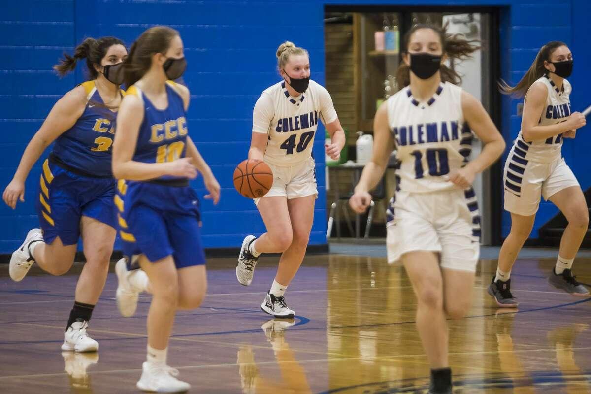 Coleman's Katelyn Pnacek dribbles down the court during a game against Carson City-Crystal Thursday, Feb. 25, 2021 at Coleman High School. (Katy Kildee/kkildee@mdn.net)