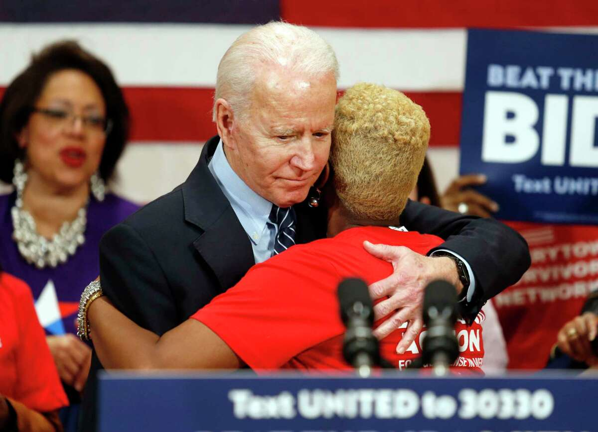 Democratic presidential candidate former Vice President Joe Biden hugs Crystal Turner of Columbus, Ohio, with Moms Demand Action during a campaign rally in Columbus, Ohio, Tuesday, March 10, 2020. (AP Photo/Paul Vernon)