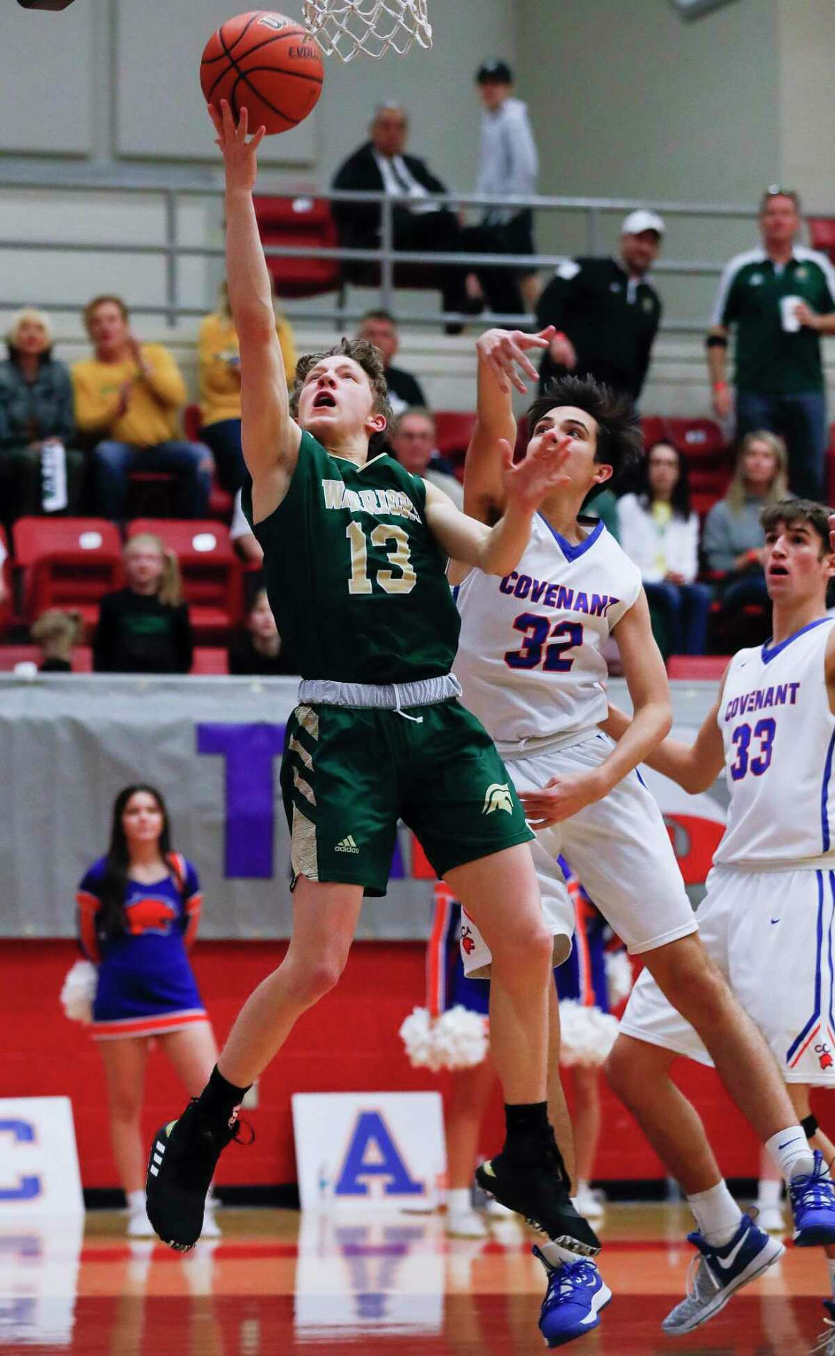 The Woodlands Christian Academy point guard Austin Benigni (13) shoots a layup during the third quarter of the TAPPS Class 4A high school basketball championship at West High School, Saturday, Feb. 29, 2020, in West.
