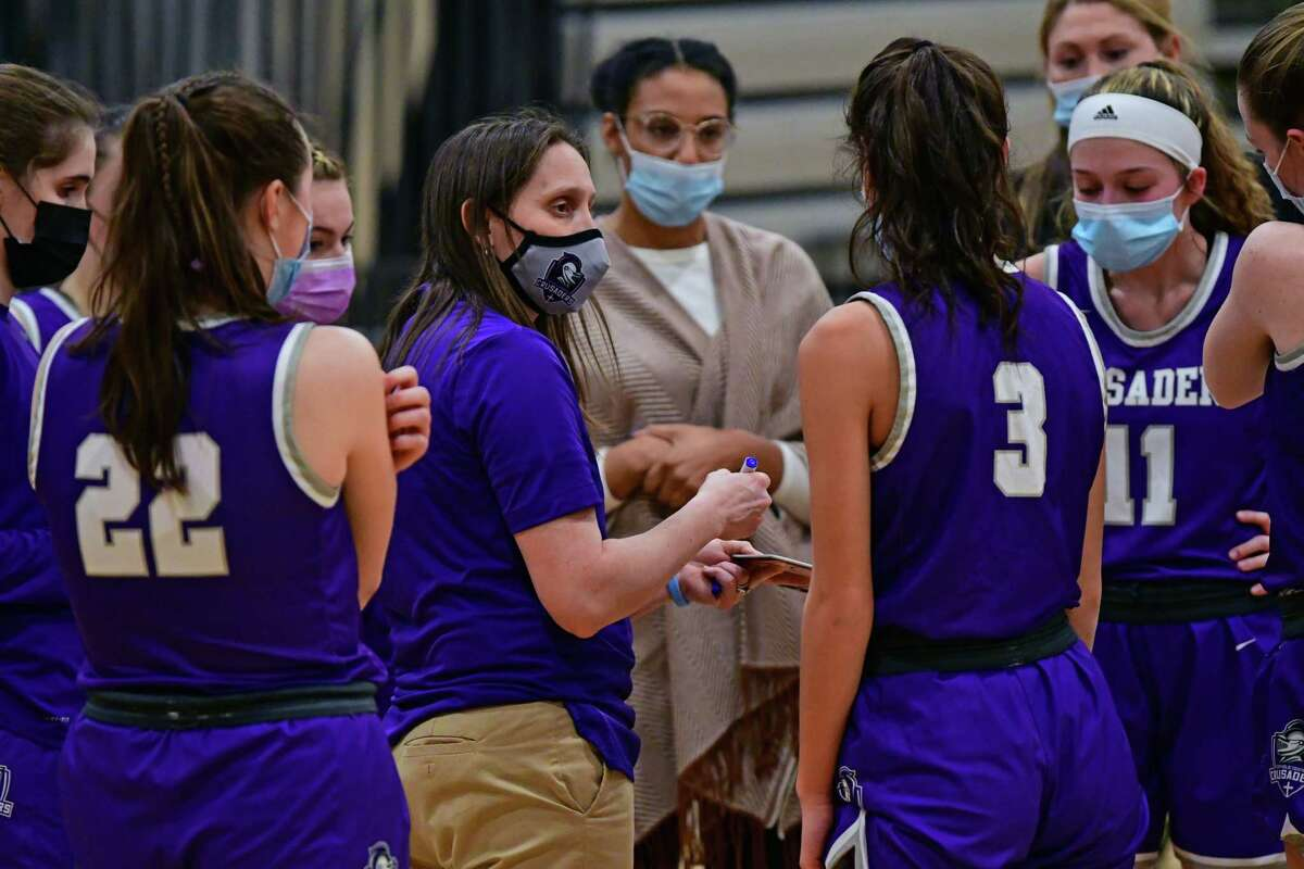 Catholic Centra head coach Audra DiBacco talks to her players at a timeout during a basketball game against Schalmont on Thursday, Feb. 25, 2021 in Rotterdam N.Y. (Lori Van Buren/Times Union)