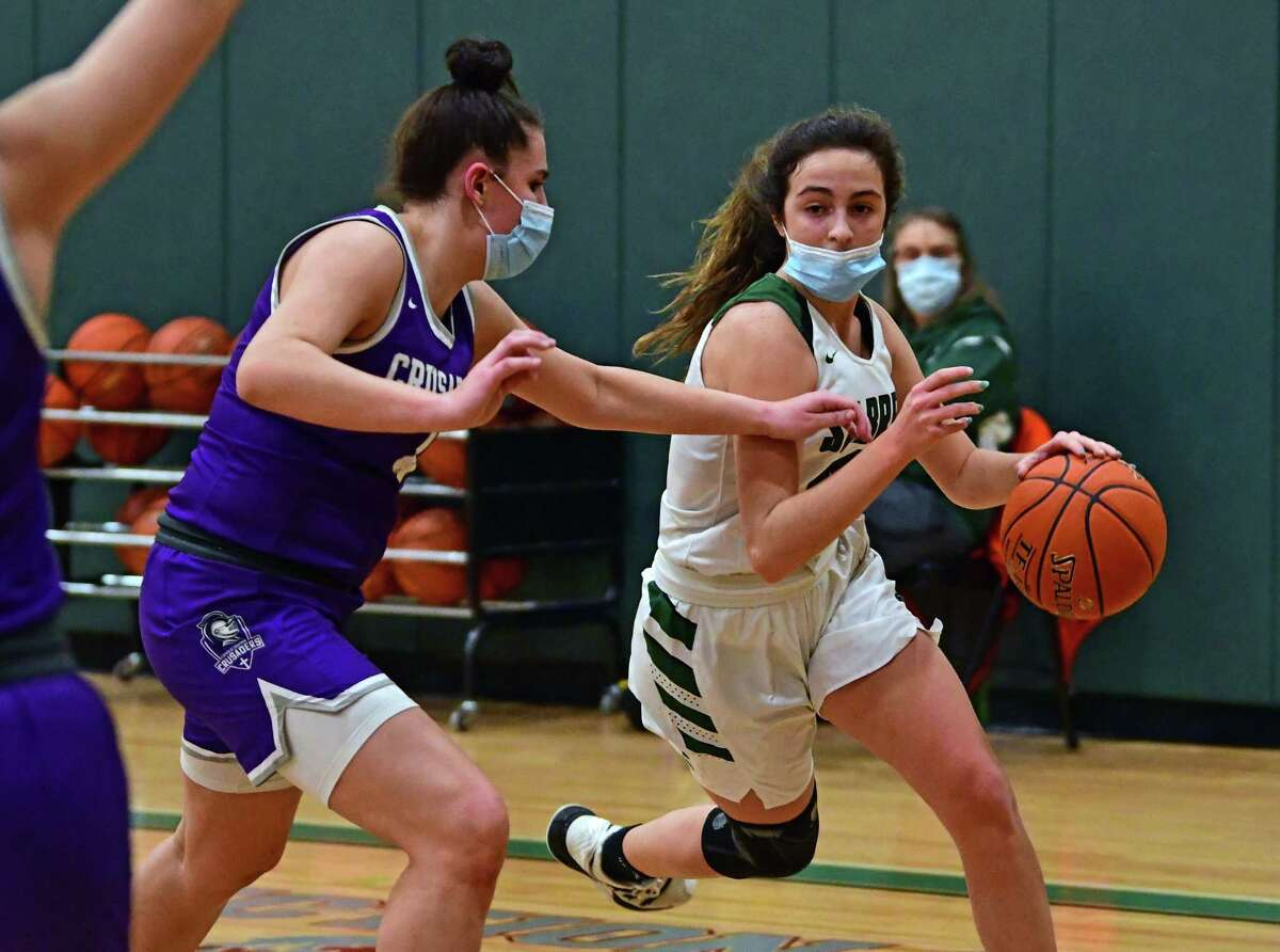 Schalmont junior point guard Payton Graber drives to the hoop defended by Catholic Central's Sarah Mattfeld during a basketball game on Thursday, Feb. 25, 2021 in Rotterdam N.Y. (Lori Van Buren/Times Union)