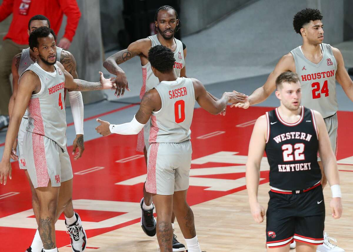 Houston Cougars celebrate a defensive stop in the first half against Western Kentucky Hilltoppers at the Fertitta Center in Houston on Thursday, Feb. 25, 2021.