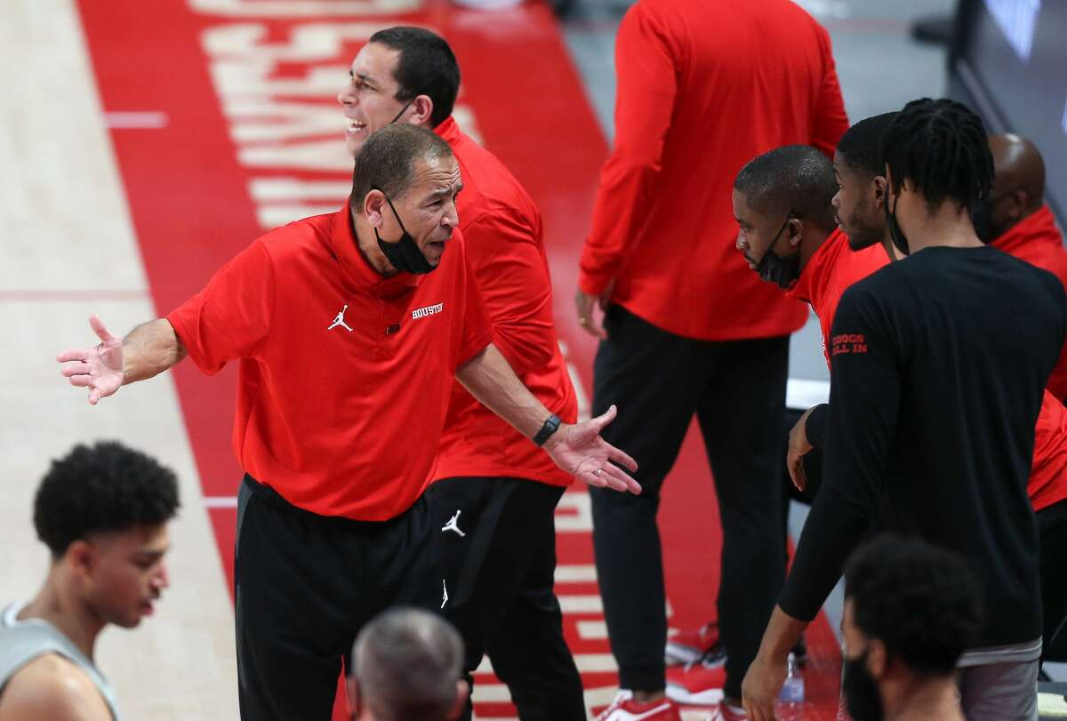 Houston Cougars head coach Kelvin Sampson talks to his staff in the second half of game action against Western Kentucky Hilltoppers at the Fertitta Center in Houston on Thursday, Feb. 25, 2021. Houston Cougars won 81-57.