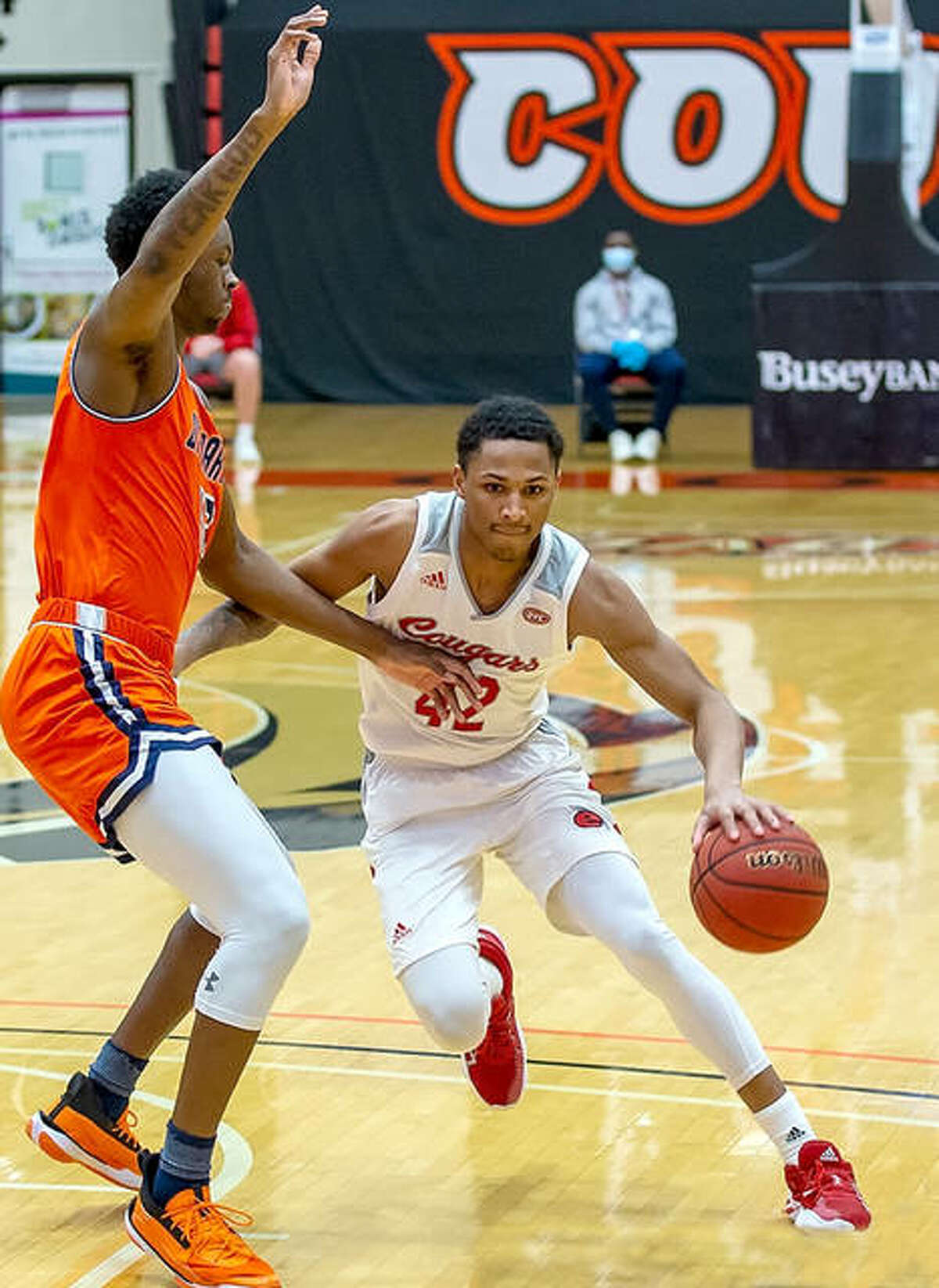 SIUE's Shamar Wright (42) drives to the basket in Thursday's 66-53 victory over UT Martin at First Community Arena. He scored 17 points and twin brother Lamar Wright scored 16 for the Cougars.