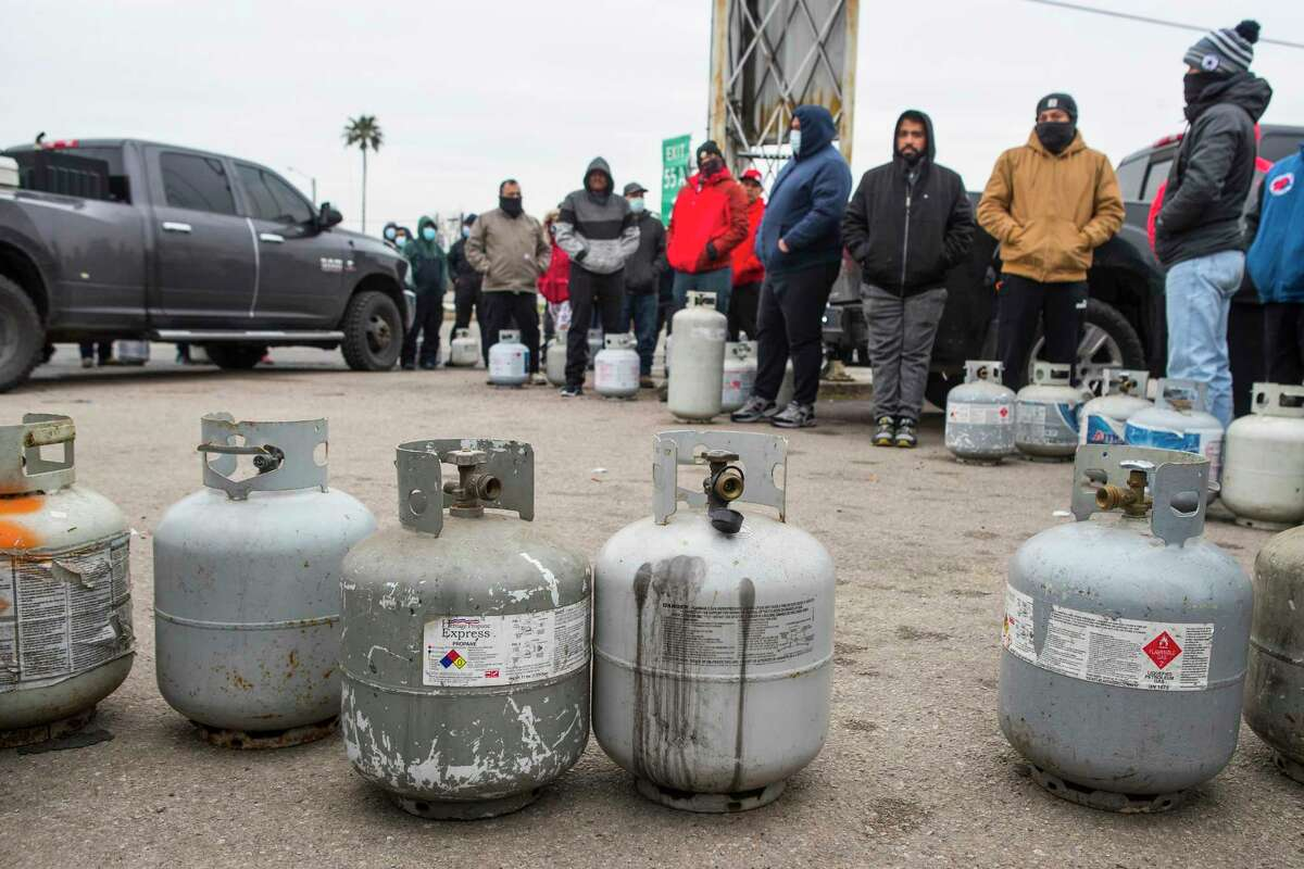 People line up to fill their empty propane tanks at a business on the North Freeway Tuesday, Feb. 16, 2021 in Houston. Temperatures stayed below freezing Tuesday, with many still without power.