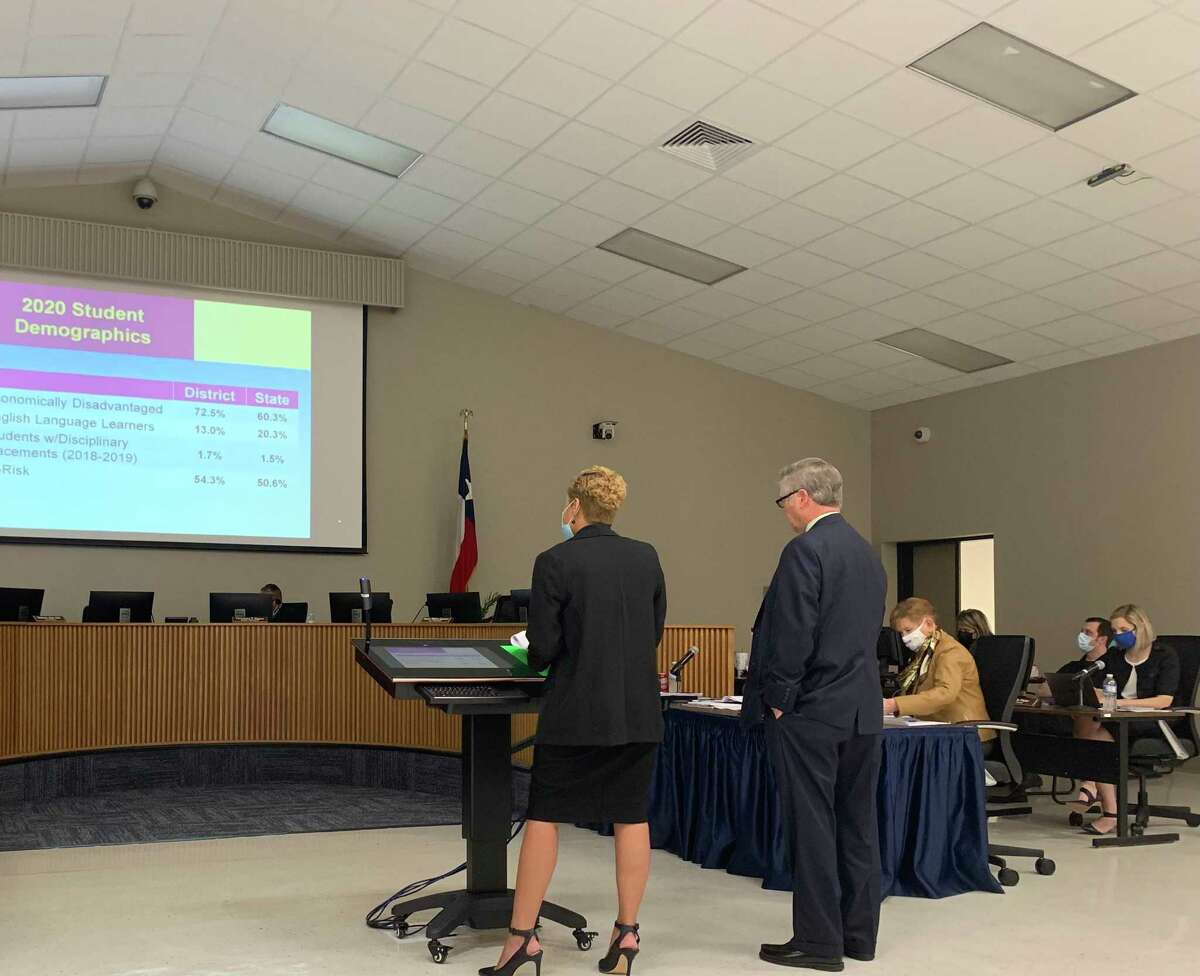 Beaumont administrators Anita Frank and Randall Maxwell present the district