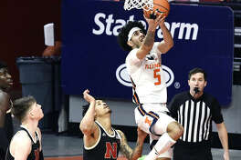 Illinois guard Andre Curbelo (5) goes up for a shot against Nebraska Thursday night in Champaign.