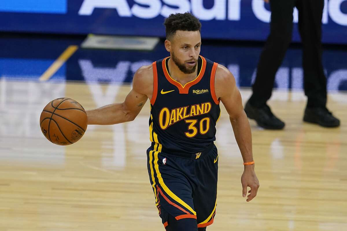 Golden State Warriors guard Stephen Curry (30) against the Miami Heat during an NBA basketball game in San Francisco, Wednesday, Feb. 17, 2021. (AP Photo/Jeff Chiu)