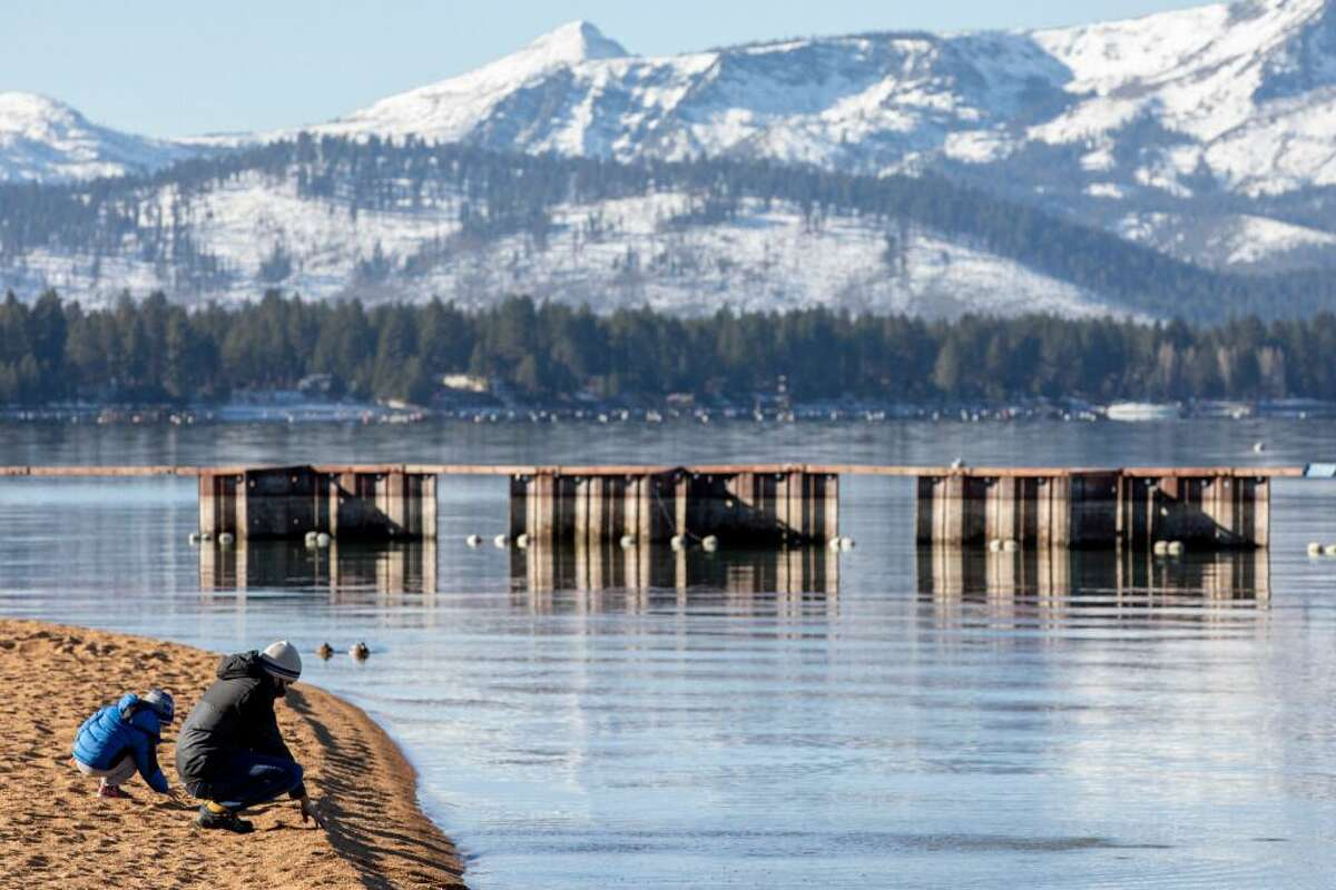 A family enjoys Lakeside Beach at South Lake Tahoe in December.