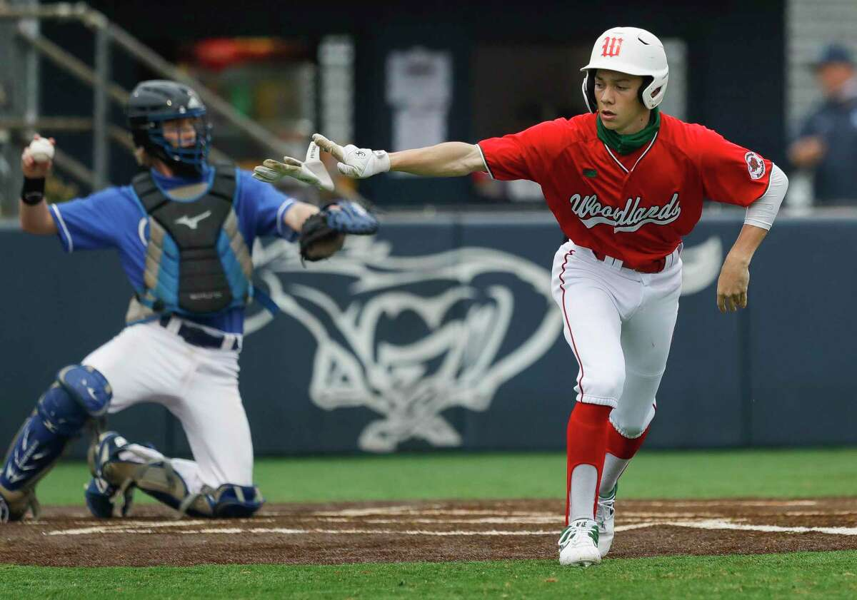 Brayden Sharp #21 of The Woodlands draws a walk during the first inning of a pre-season baseball game at Kingwood High School, Thursday, Feb. 25, 2021, in Kingwood.