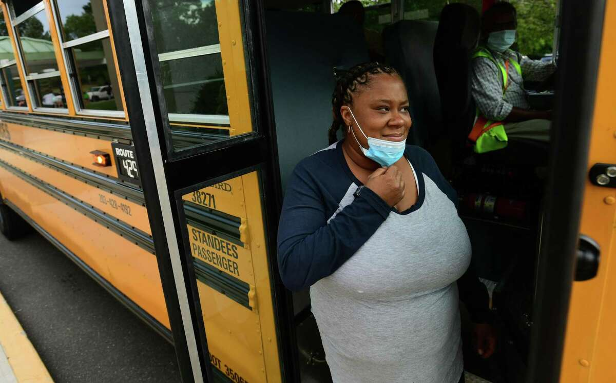 Bus monitors including Tanesha Joyner help students board buses at Fox Run Elementary School Thursday, September 16, 2020.