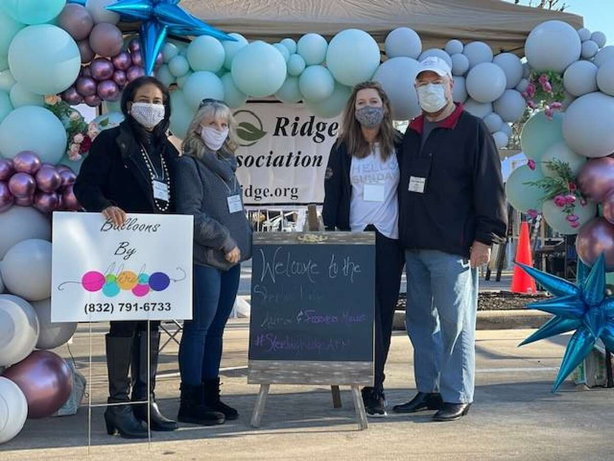 Organizers of the new Sterling Ridge Village Artisans and Farmers Market pose after their first market on Feb. 7. From left are: Rashmi Gupta, treasurer; Robbye Schwarzkopf; Nicole Jackson; and Fred Lederman. The second edition of the market on Feb. 21 was also successful, officials said, despite the winter storm blasting much of the region.