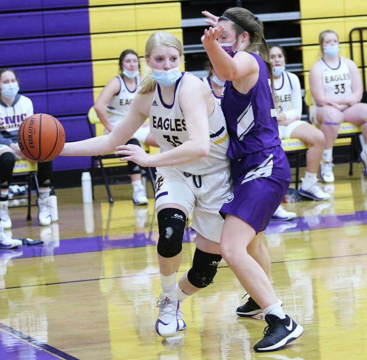 CM's Claire Christeson (left), shown passing off a baseline drive against Breese Central in a Feb. 9 game in Bethalto, scored 15 points Thursday night in the Eagles' MVC victory at Mascoutah.