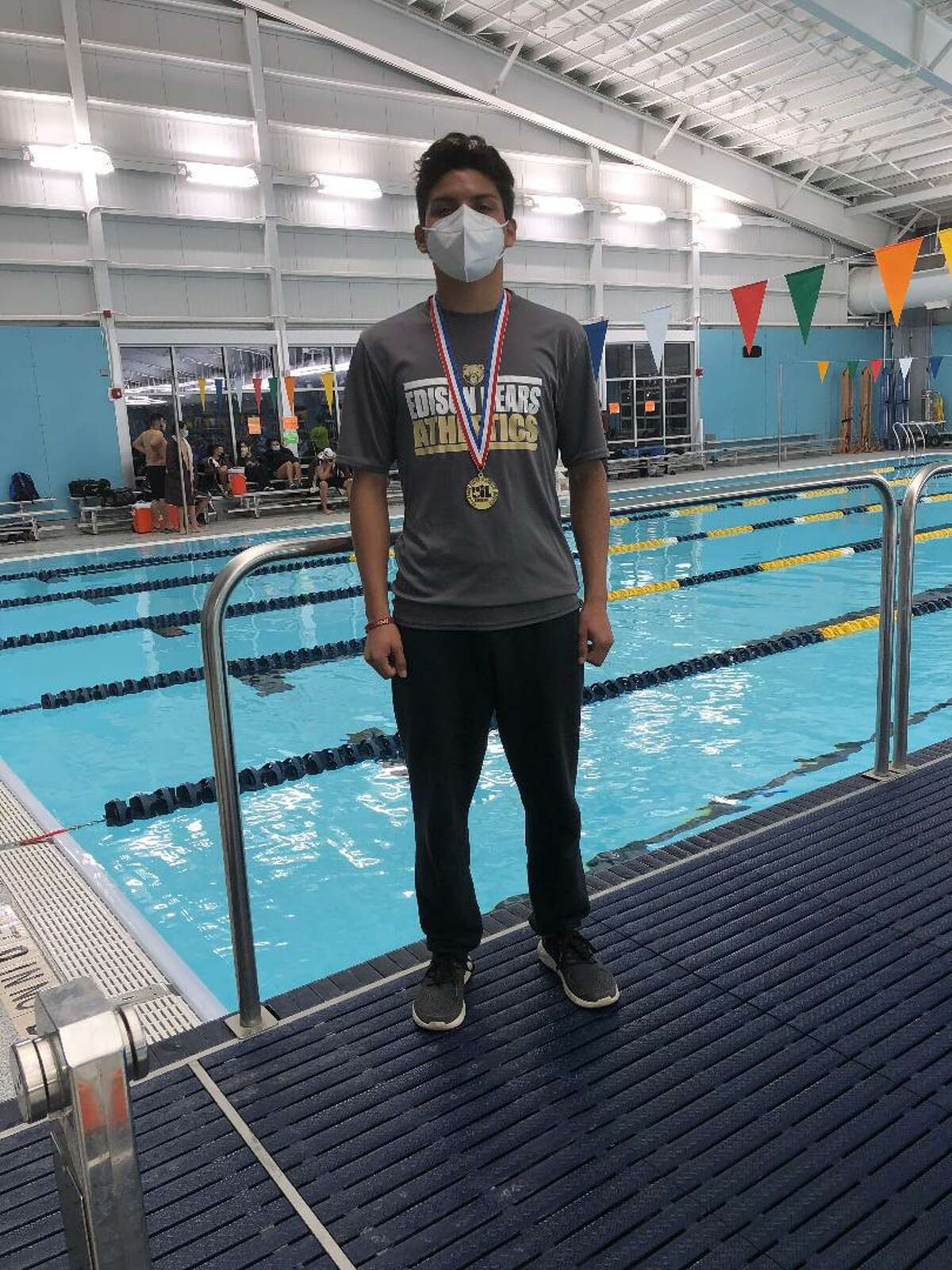 Edison High School senior Christian Rangel wears the gold medal he won at the Class 5A regional diving meet on Feb. 6. The win earned him a spot to compete at the UIL Swimming and Diving State Meet on Saturday at Josh Davis Natatorium. He will be competing in the Class 5A 1-meter diving event.