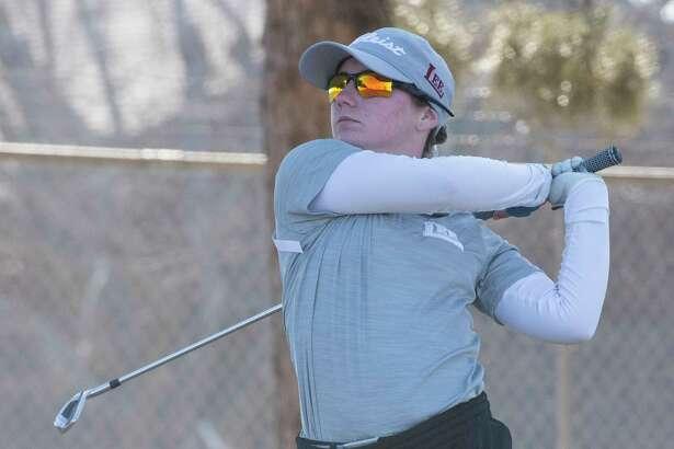 Lee High's Sarah Reed follows her shot 02/26/2021 at Ranchland Hills Golf Club. Tim Fischer/Reporter-Telegram