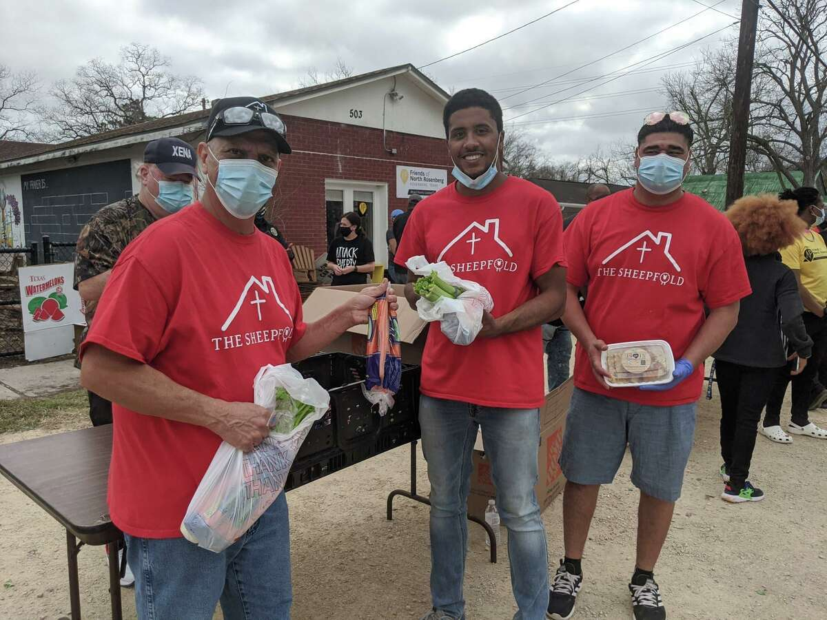 Volunteers assemble outside Friends of North Rosenberg to distribute personal protection equipment kits, food and bottled water to residents.