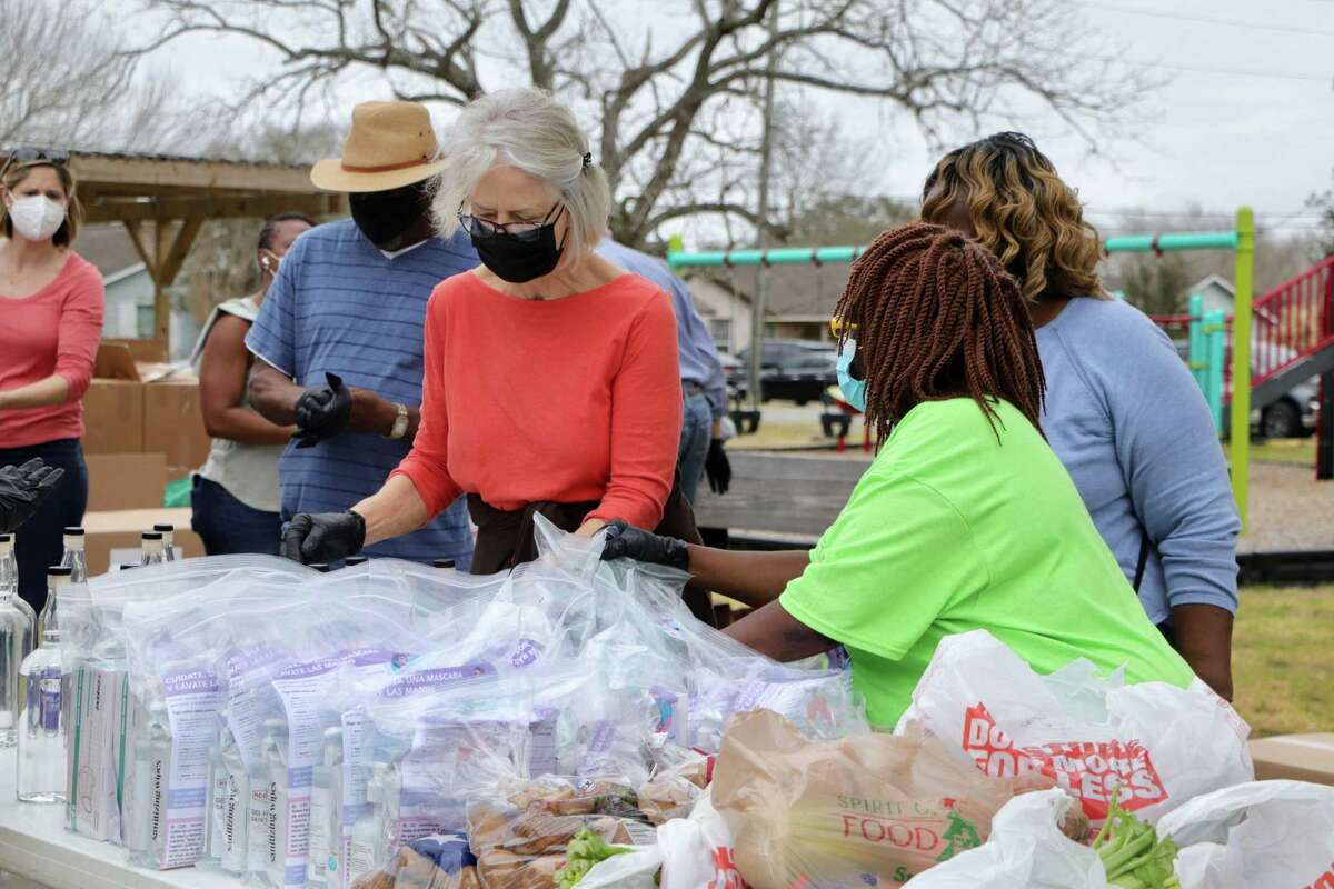 Volunteers distribute personal protection equipment, groceries and meals to Richmond residents.