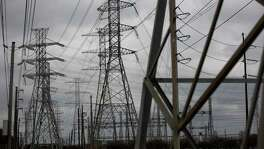 Power lines in Houston. The Public Utility Commission's order to push prices to the state maximum of $9,000 per megawatt hour during the power crisis has become controversial.