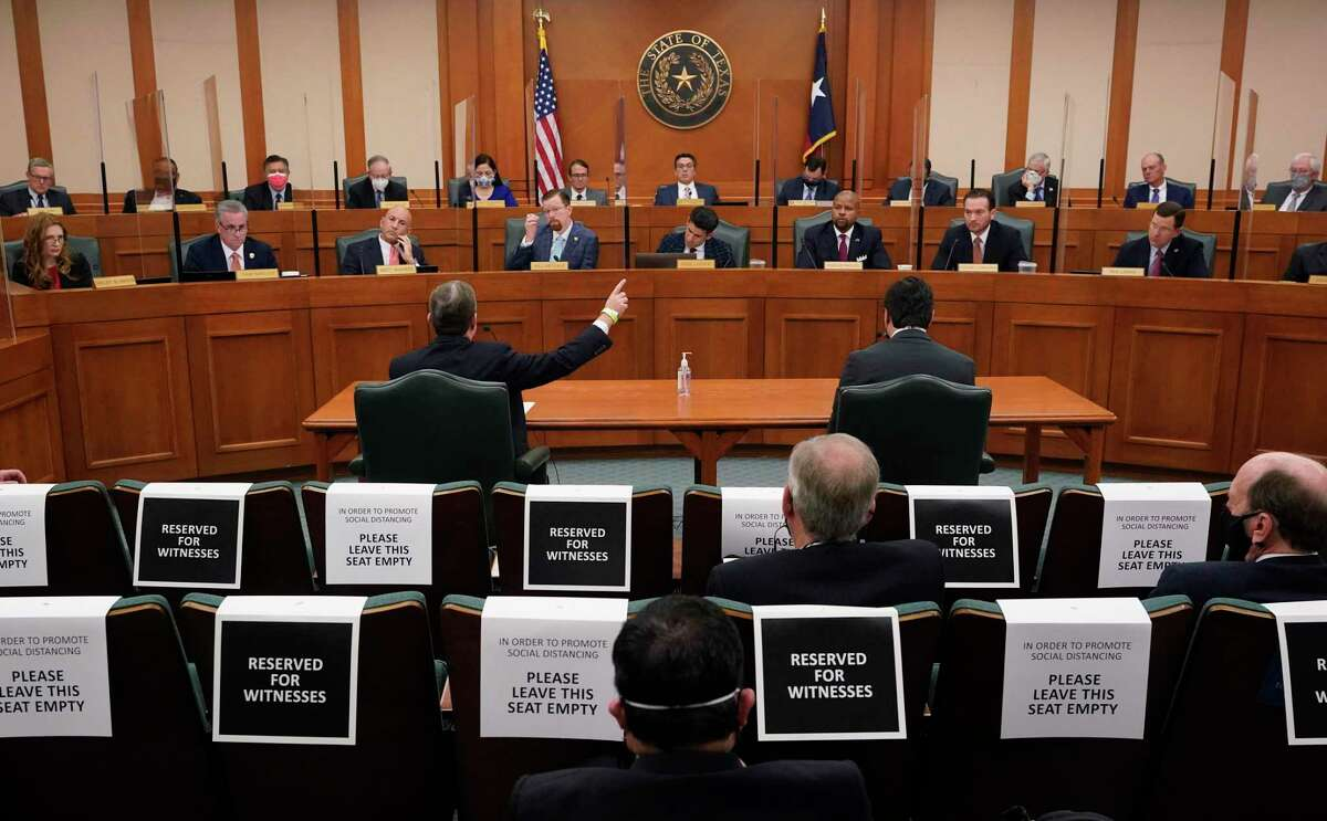 Witnesse Kirk Morgan, at table left, testifies as the Committees on State Affairs and Energy Resources holds a joint public hearing to consider the factors that led to statewide electrical blackouts, Thursday, Feb. 25, 2021, in Austin, Texas. The hearings were the first in Texas since a blackout that was one of the worst in U.S. history, leaving more than 4 million customers without power and heat in subfreezing temperatures. (AP Photo/Eric Gay)