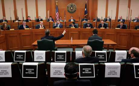 Witness Kirk Morgan, at table left, testifies as the Committees on State Affairs and Energy Resources holds a joint public hearing to consider the factors that led to statewide electrical blackouts, Thursday, Feb. 25, 2021, in Austin, Texas. The hearings were the first in Texas since a blackout that was one of the worst in U.S. history, leaving more than 4 million customers without power and heat in subfreezing temperatures. (AP Photo/Eric Gay)