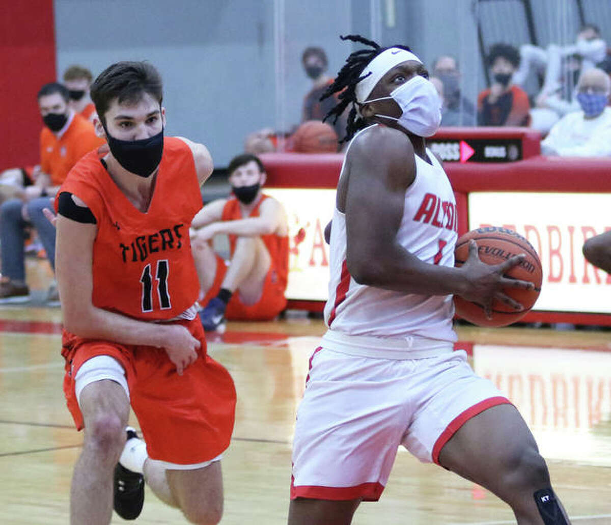 Alton's Ja'Markus Gary (right) scored 19 points Thursday night, but the Redbirds fell to East St. Louis 59-31. He is shown in action earlier this season against Edwardsville.