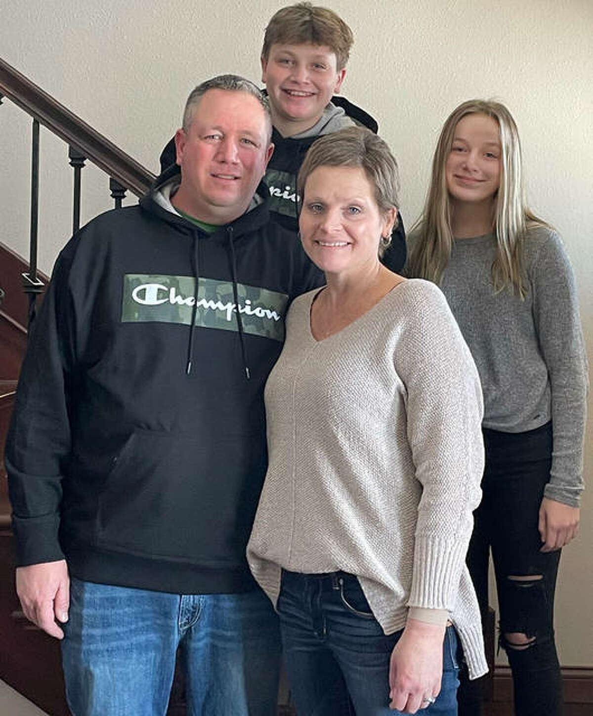 Beth Rull is pictrured in her Bunker Hill home along with her husband, Brandon, their son, Nick, and their daughter, Sophie.