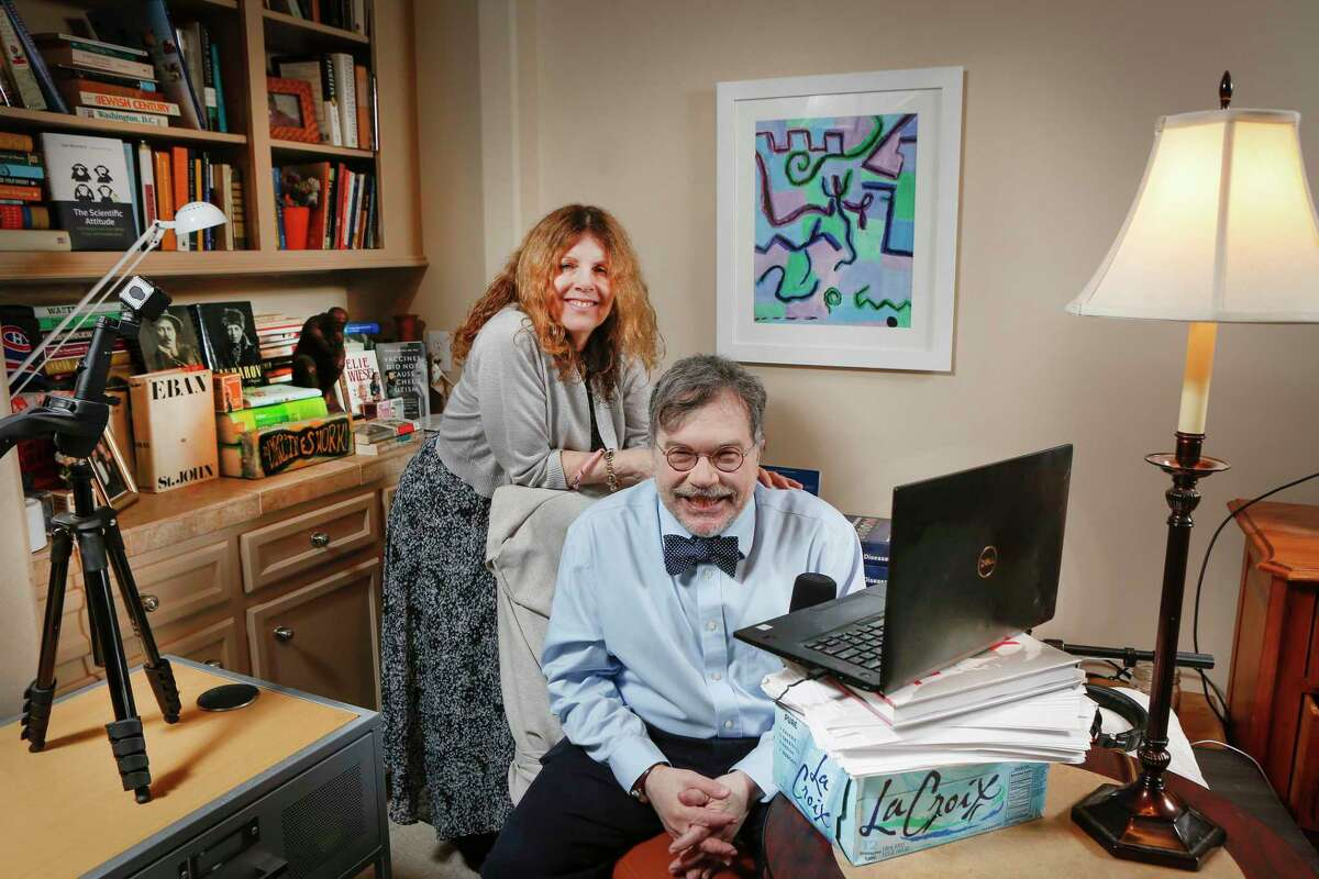 Vaccine researcher Peter J. Hotez, MD, PhD and his wife Ann Hotez in their home Thursday, Feb. 25, 2021, in Houston. The painting on the wall was painted by their autistic daughter Rachel when she was younger.