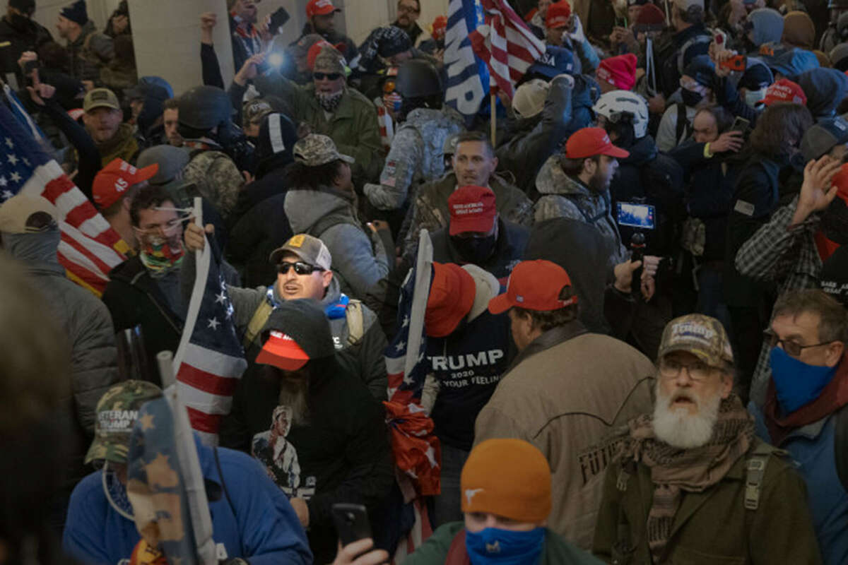 Pro-Trump protesters entered the U.S. Capitol building during demonstrations in the nation's capital Jan. 6. A circle is drawn around Andrew Alan Hernandez, according to an FBI report on him.