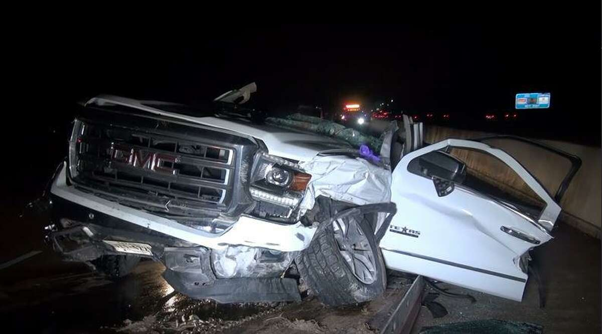 A 2014 GMC truck is seen Thursday, Feb. 25 after it was reportedly struck by an airborne tire off a 2004 Dodge pickup. Upon impact, the woman driving the GMC was killed.