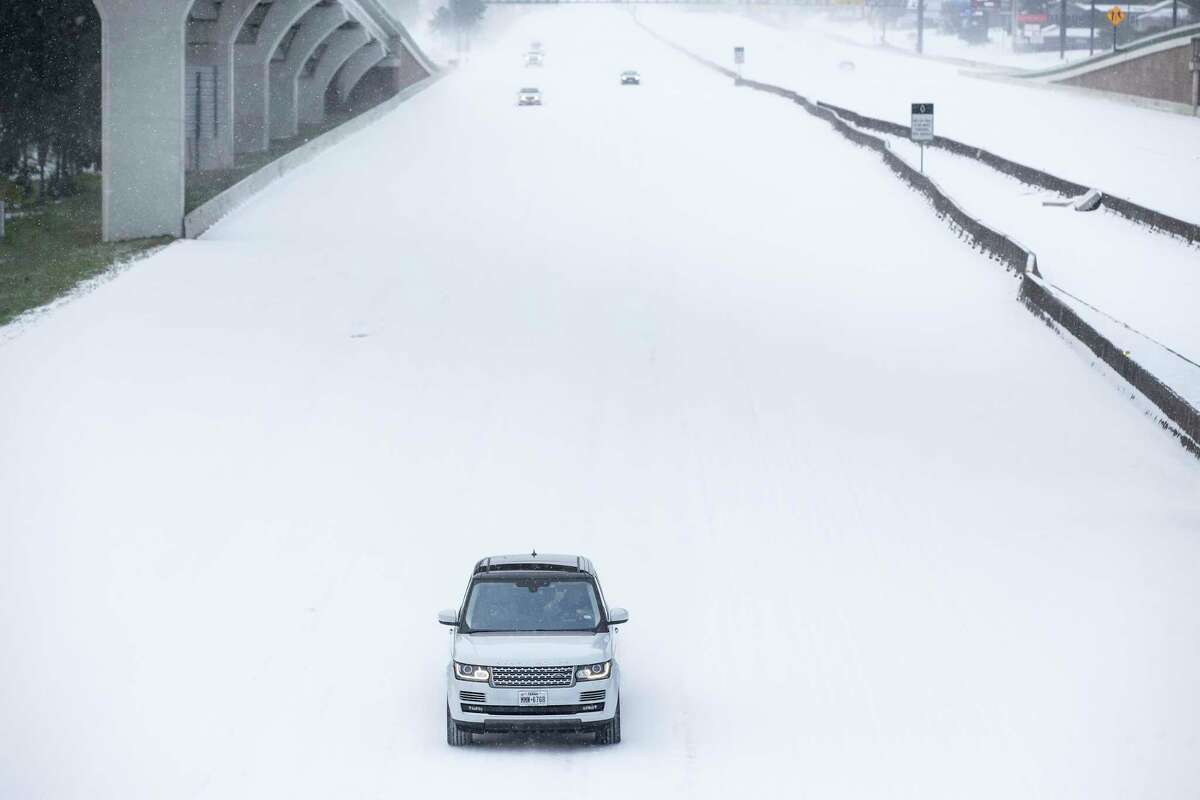 Traffic is sparse on the snow-covered I-45 near The Woodlands Parkway following an overnight snowfall Monday, Feb. 15, 2021 in The Woodlands. The prolonged snow on the ground will also have an impact on plants in the area.
