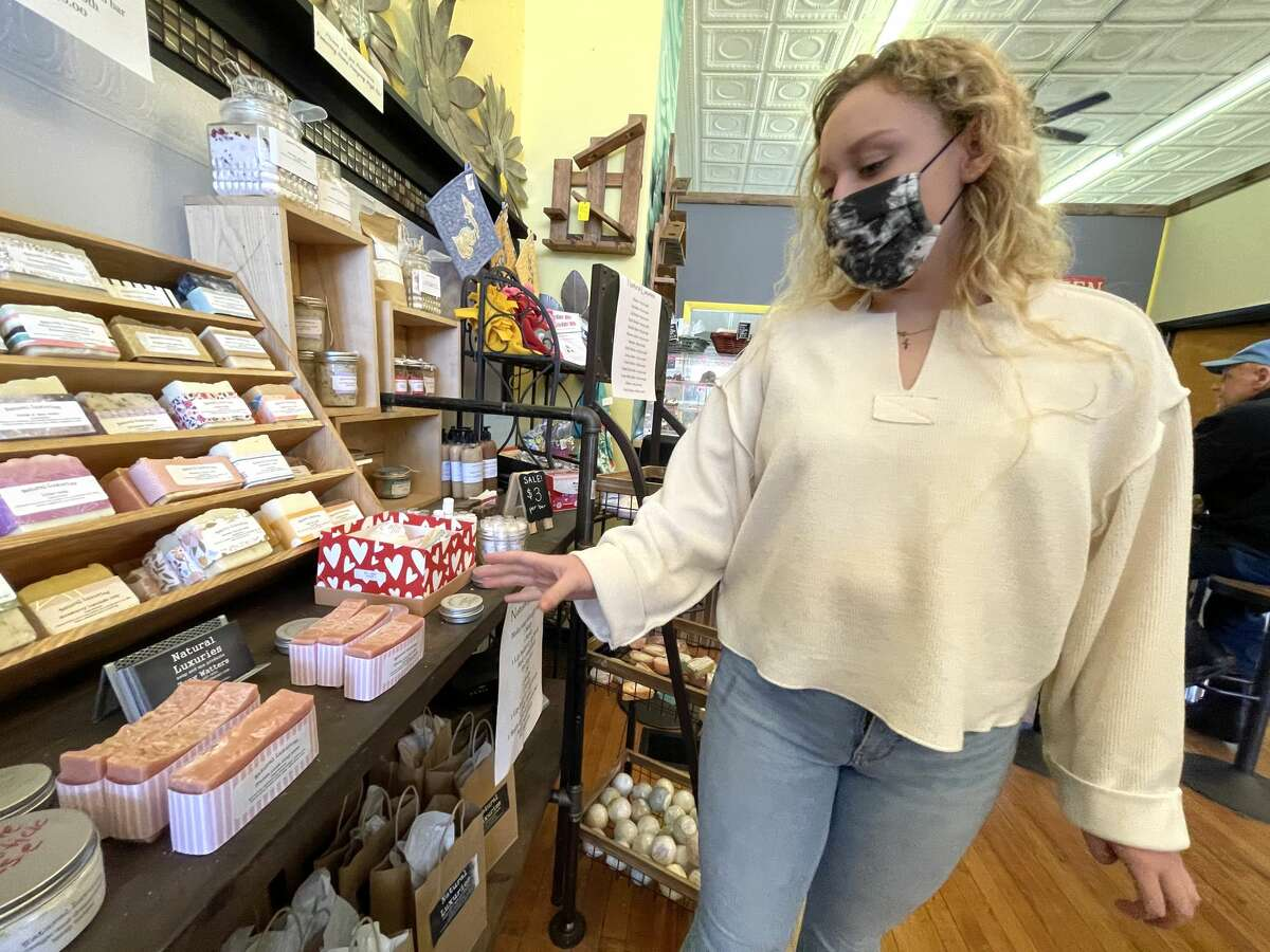 Big Rapids senior Zoey Watters shows some of her products on display The Yellow Window in Big Rapids.