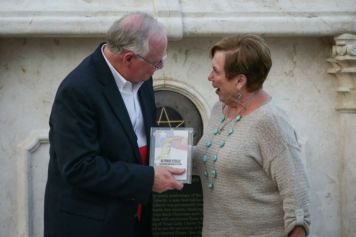 Chairman and CEO Dean Bass, of Spirit of Texas Bank, presents a commemorative plaque to Barbara Smith on behalf of Alfonso Steele during the San Jacinto Day Ceremony on Friday, April 21, 2017, at Spirit of Texas Bank. Alfonso Steele, of Montgomery County and sixth company, was the last survivor of San Jacinto. In that battle, while mounted by Sam Houston, Steele's gray horse met death.