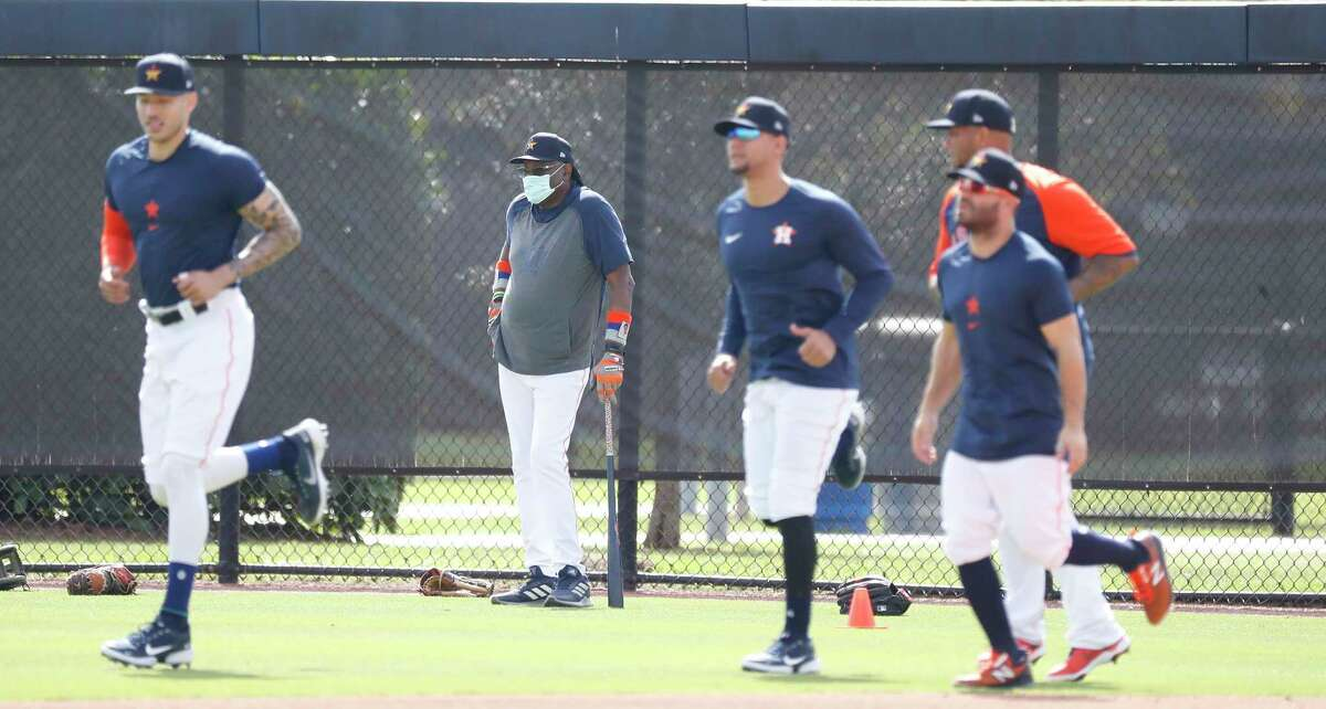 Houston Astros manager Dusty Baker watches his position players warm up during spring training workouts for the Astros at Ballpark of the Palm Beaches in West Palm Beach, Florida, Friday, February 26, 2021.