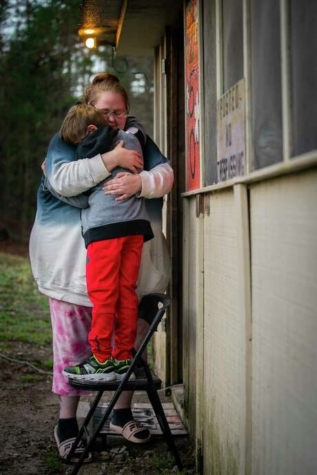 Alex Blanchard hugs her son, 9, outside their Hot Springs, Ark., home in January 2021. The family moved to Arkansas after her son was assaulted at Austin Oaks Hospital, a private psychiatric hospital in Austin, in 2017, a lawsuit alleges. Photo: Mark Mulligan, Houston Chronicle / Staff Photographer / © 2021 Mark Mulligan / Houston Chronicle