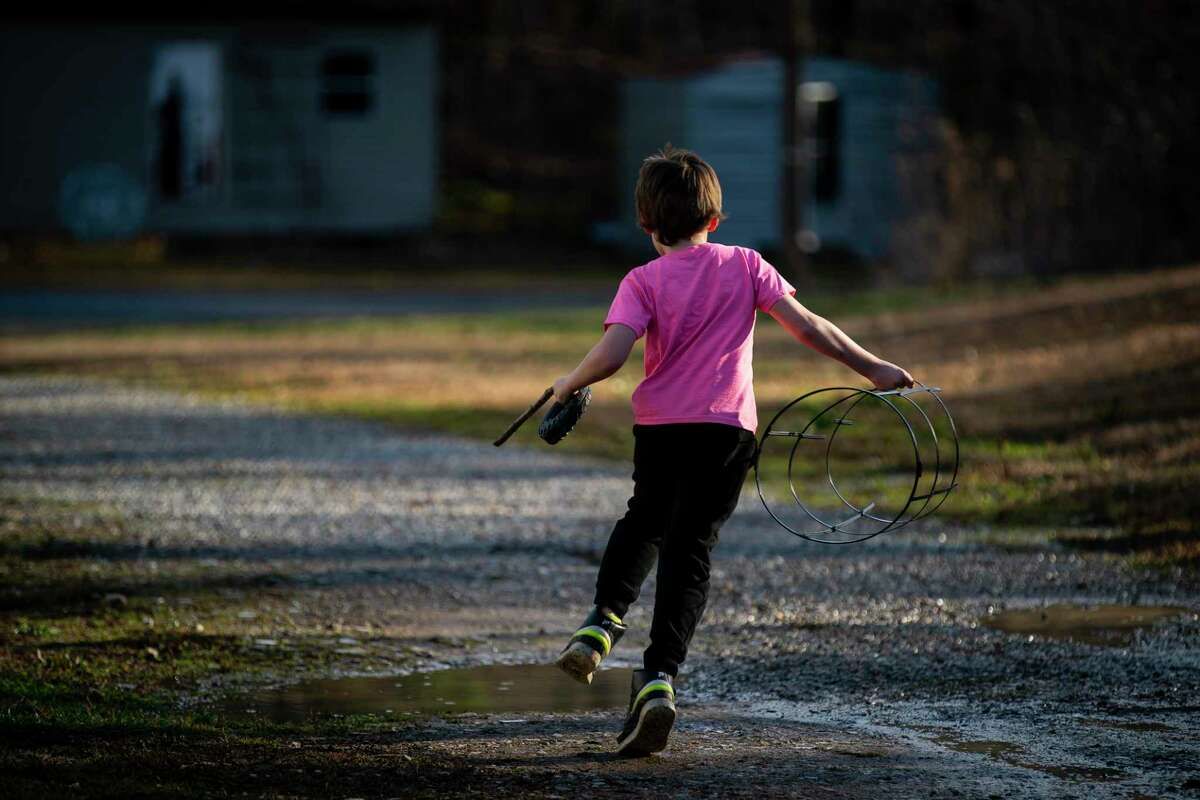 Alex Blanchard's son, 9, plays on his grandfather's property, Monday, Jan. 25, 2021, in Hot Springs, AR. Blanchard's son was five in 2017 when he was assaulted by a 13 year-old boy at Austin Oaks Hospital, a private psychiatric hospital in Austin, TX. Blanchard is now suing the hospital.