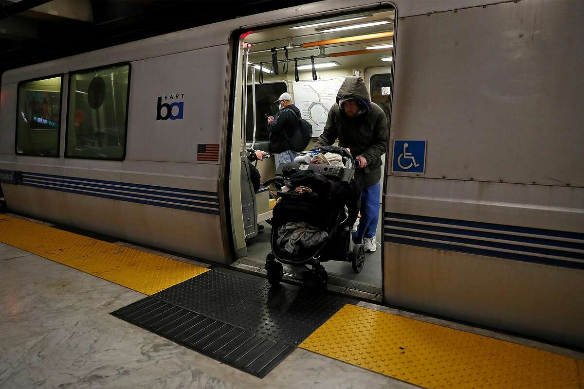 """A homeless man identifying himself as """"Ricky"""" exits a train at Civic Center BART station in San Francisco, Calif., on Wednesday, February 25, 2021."""