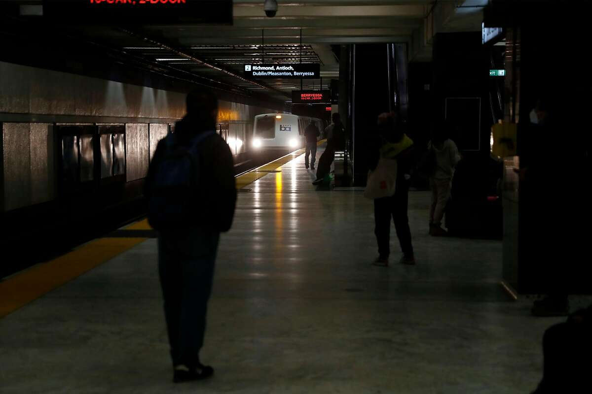 Commuters await an arriving train at Civic Center BART station in San Francisco, Calif., on Wednesday, February 25, 2021.