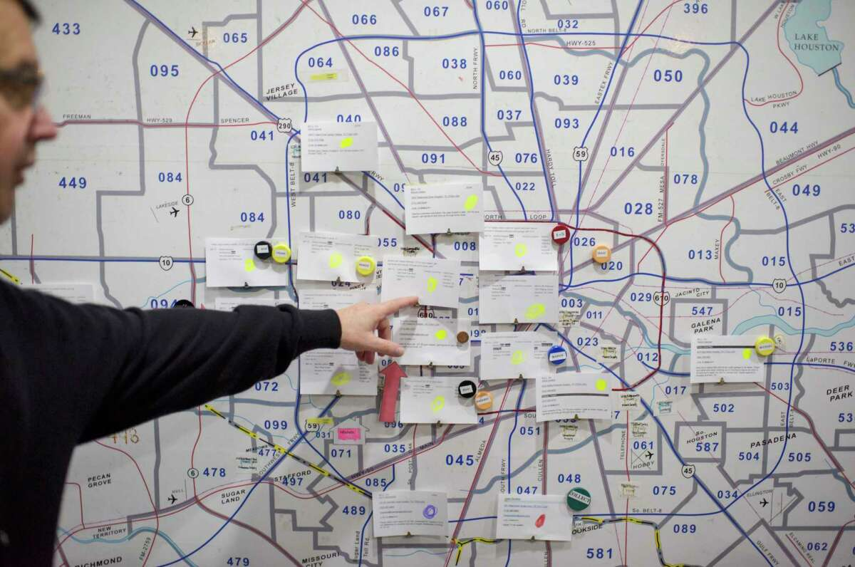 A plumber points to a map of the Houston region showing calls for help after the recent winter storm. The city of Deer Park is urging residents who suffered winter storm damage report the damage via an online survey to help the state get a better understanding of damages.