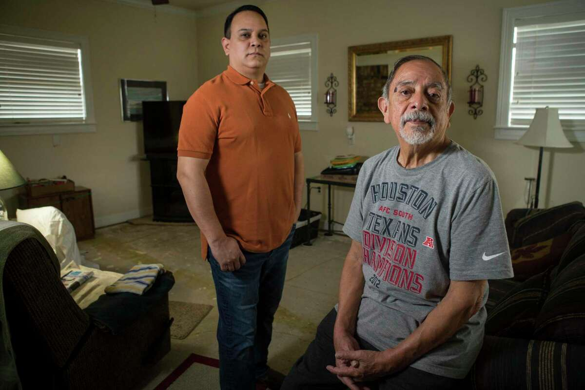 Isaac and Lawrence Ibarra, who are mourning the loss of Isaac's brother, Gilbert Rivera, pose for a portrait Wednesday, Feb. 24, 2021 in Houston. Rivera died of hypothermia after his apartment lost power amid bitter cold temperatures during the week of Feb. 14, 2021.