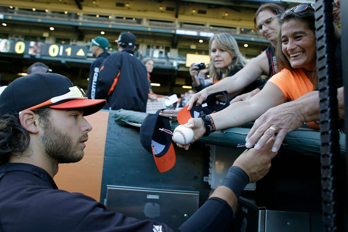 San Francisco Giants shortstop Brandon Crawford signs autographs before a 2013 game against the A's in San Francisco.