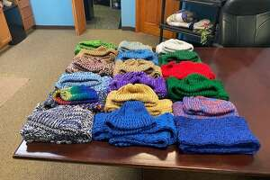 A donation of knitted hats and scarves from the Assumption of the Blessed Virgin Mary Parish was delievered to the Midland Community Former Offenders Advocacy and Rehabilitation on Feb. 24, 2021 (Photo provided/Rob Worsley)
