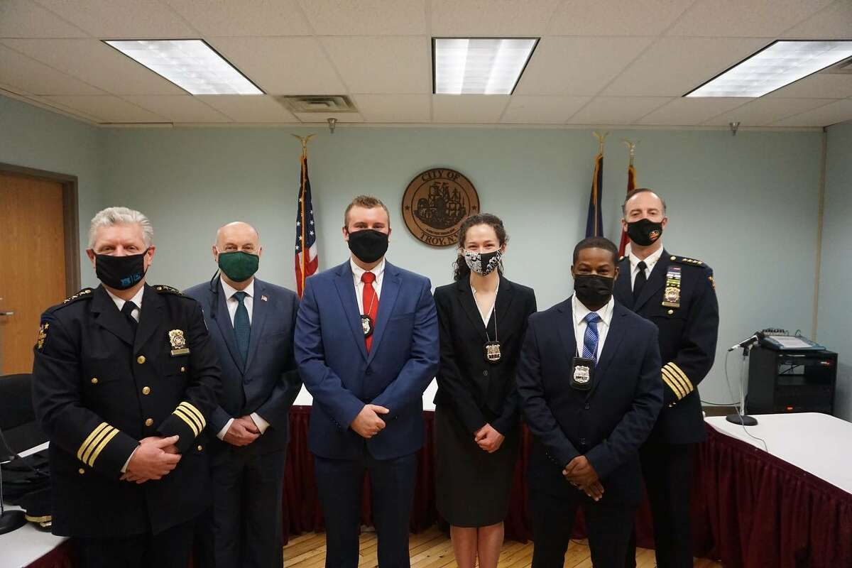The Troy Police Department swore in seven new officers in ceremonies at City Hall. On Feb. 16, 2021 three of the officers joined the department. From left are Deputy Chief Dan DeWolf, Mayor Patrick Madden, new officers William T. (Tom) Sausville, Marykate Montemagno and Steven Clermont adn Chief Brian Owens.