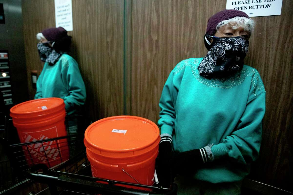 Maria Martinez rides the elevator to her apartment with a bucket of water from the River Walk, so she can flush her toilet. Readers say they're outraged by price gouging during the storm.