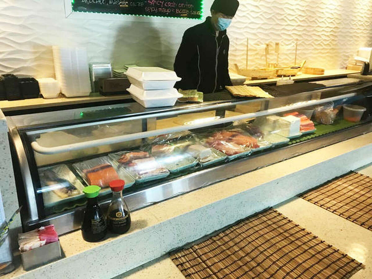 A to-go order of sushi rolls awaits on top of the sushi bar at Shogun Japanese Steakhouse, at 2723 Corner Court, just off Homer Adams Parkway, in Alton.