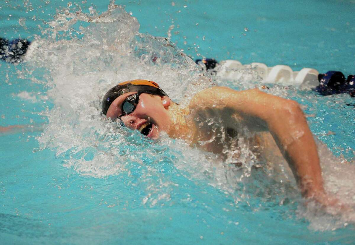 Ridgefield's Connor Hunt competes in the 500 yard freestyle during swim action in New Haven, Conn., on Thursday Mar. 14, 2019.