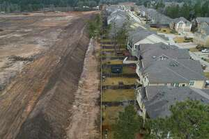 A debris wall behind several homes in the Biltmore subdivision in Montgomery has returned, Friday, Feb. 26, 2021. Montgomery County filed a lawsuit on Oct. 2 against Justin Hasara, whose company built a massive wall of trees and brush that reached 25 feet high and spanned more than six football fields. In December 2020, A Montgomery County judge has granted an injunction against a local landowner to stop using his property in Woodforest as a dumpsite and to have the property cleaned up in 90 days.