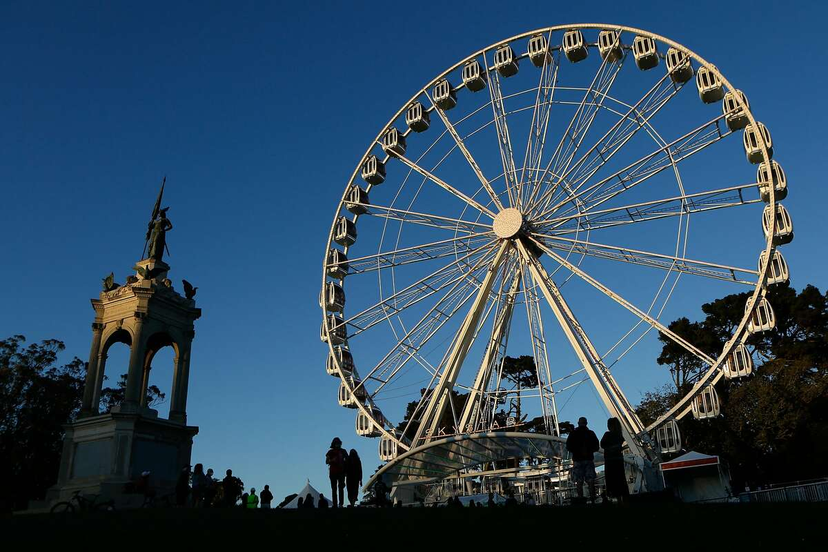 The SkyStar Ferris wheel, meant to commemorate Golden Gate Park's 150th anniversary, is seen with its lights on for the first time on Oct. 20 after a delay due to the pandemic.