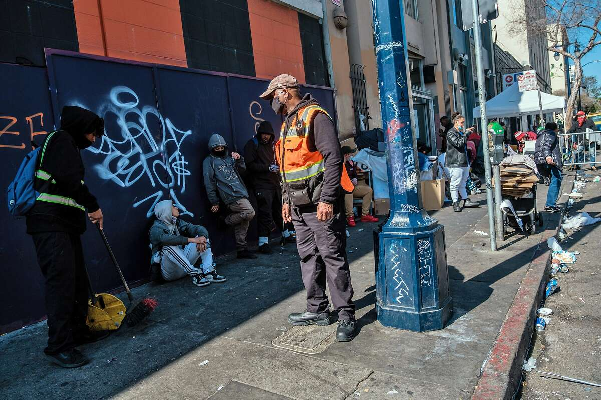 Private security guard Ron Haysbert keeps an eye on the sidewalk on the corner of Hyde and Golden Gate, a known corner for drug traffic, where La Cocina is preparing to open a new space for immigrant women to sell their food.