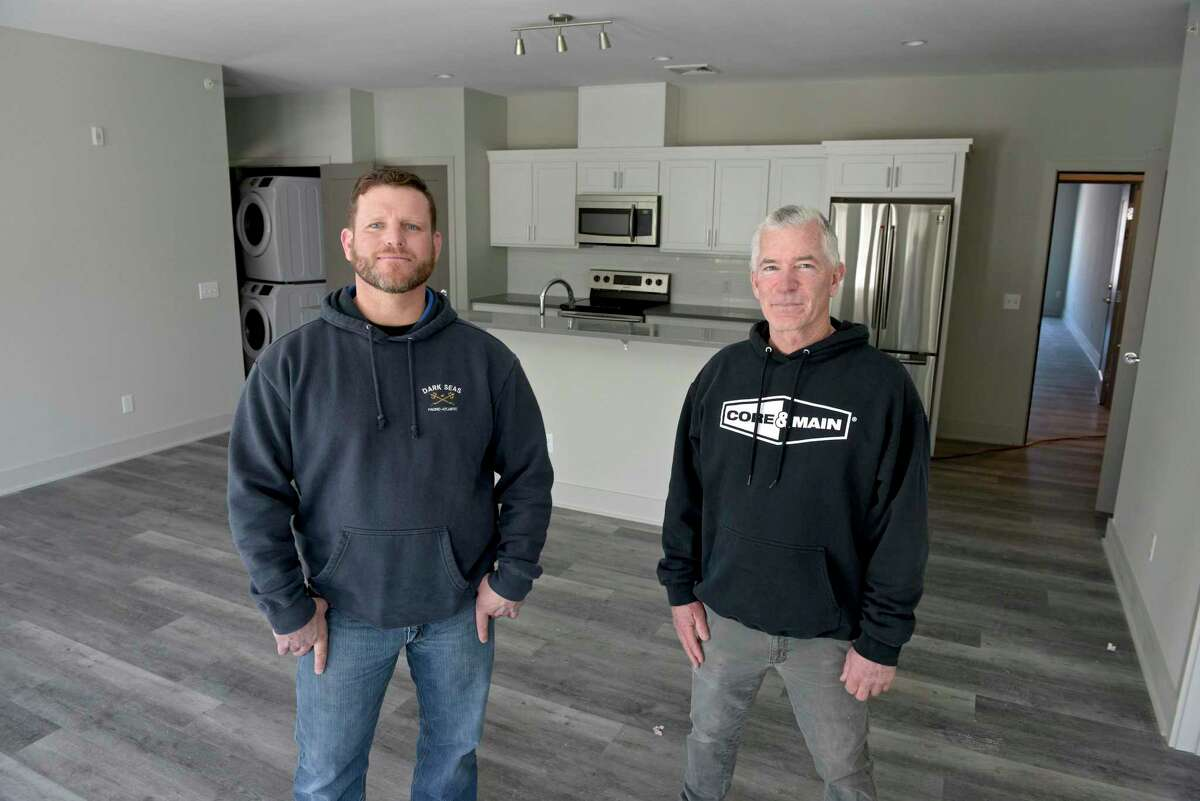 Mark Sirico, of Farrell Building Co., left, and Michael Burton, of Michael Burton Builders Inc., in a two bedroom apartment of a new residential development, Farrell Communities of Sandy Hook, in Newtown, Conn. Friday, February 26, 2021.
